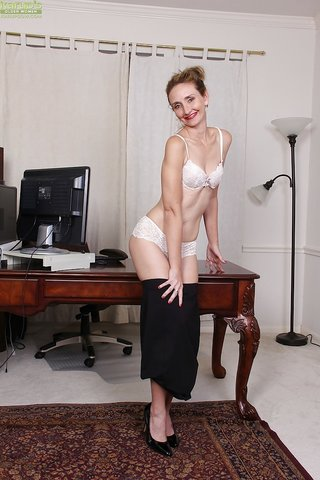 stripping sexy business woman